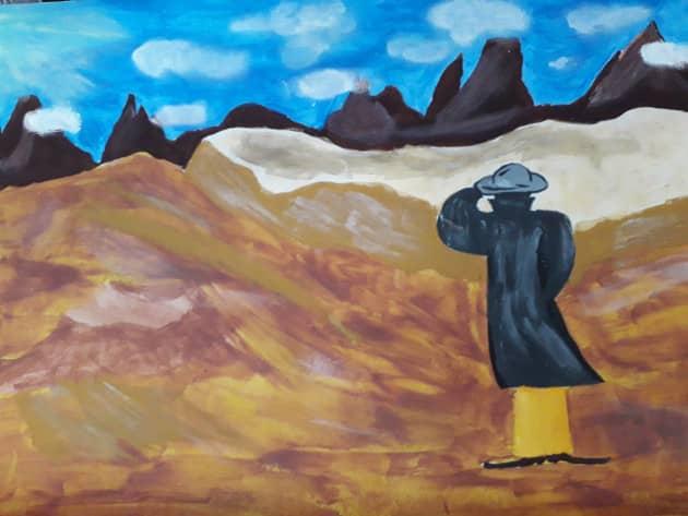 Человек в желтых штанах.В золотой пустыне.